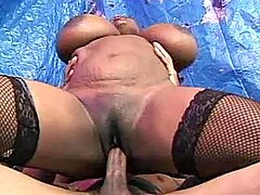 Fat black vixen takes care of dick