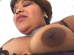 Chubby ebony in stockings enjoys dildo